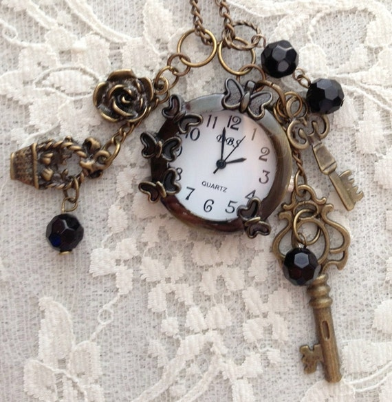 Butterflies and Flowers Small Pocket Watch.  Antique Bronze Tone