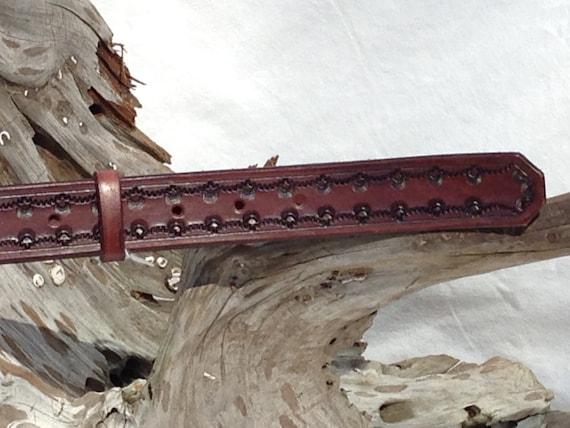 Stamped design belt