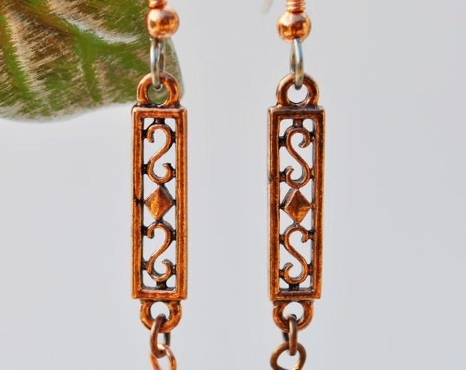 Intricately carved dangles in Copper  Earrings with Topaz Swarovski crystals