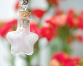 Cloudy potion necklace. Cloudy sky inside a star potion necklace. Glow in the dark.