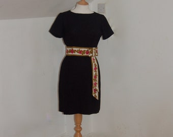 Classic 1950's vintage  figure hugging black linen wiggle dress with a gorgeous flower pattern embroidery tie waist detail