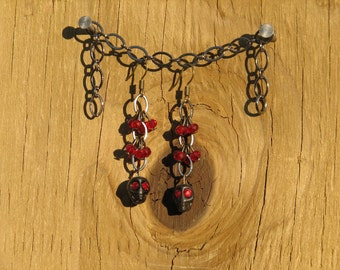 Black Skull Dangle Earrings with red crystals