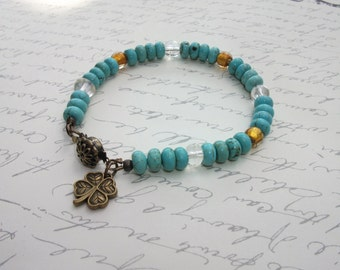 Turquoise and amber lucky charm bracelet