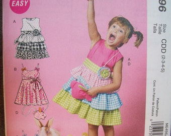 McCalls M6496. New and uncut. Easy dress pattern for girls.