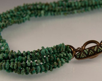 Emerald Valley Turquoise Necklace - Emerald Valley turquoise pebbles with an inlaid bronze clasp and bronze cones
