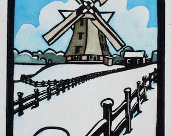 Snowy Dutch windmill print, handmade painted lino print of windmill in winter, De Zwarte Ruiter in Aalsmeer. Mounted, unframed.