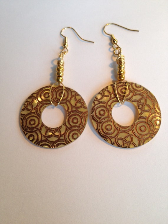 Mother of Pearl earrings with circle design, gold-color seed beads and gold plated wire..