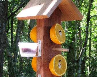 Cedar wooden birdfeeder for orioles - serve fruit and jelly from this double sided hanging bird feeer  to attract fruit eating wild birds