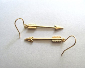 Small golden arrow earrings on 14k gold fixtures