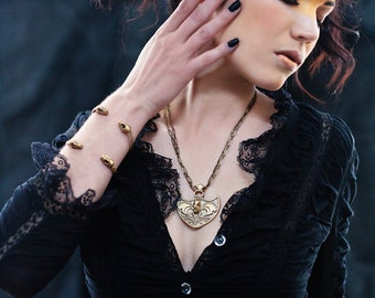 Miyu Decay Tribal Coat of Arms Necklace in Brass