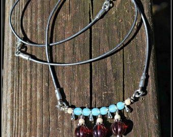 Metallic Silver Leather Chord Necklace with blue and red glass beads and silver drops