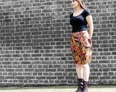 Super feminine knee length skirt in floral print, with big pockets and deep pleats, UK size 12, earthy colours, brown orange green. For her.