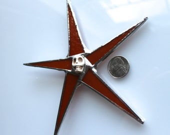 Bonehead Star-- burnt orange stained glass star 5.5 inches wide