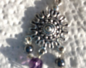 Purple swarvoski cystals, with onyx on hand twisted silver headpins suspended on chandelier earrings findings