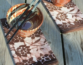 pair of chocolate batik dinner napkins