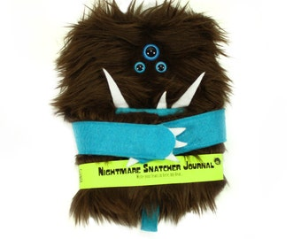 Nightmare Snatcher children's monster journal, brown blue furry monster spell book Crubbly