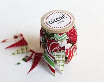 Christmas Fabric cake Mini Bunting. Wooden spool of ribbon for gift wrapping and decorating