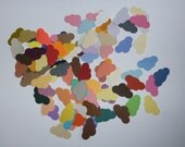 "Embellishments hand punched 50 1"" x 1/2"" cloud shapes"
