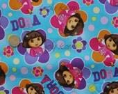 Totally Dora Floral Badges Blue Fabric - Half Yard
