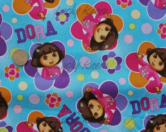 Totally Dora Floral Badges Blue Fabric - Half Yard