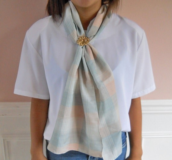 """Long scarf with soft checks of pink and blue.  Sutle look for a dress, suit or any outfit.  Enjoy this 54"""" by 10"""" long scarf."""