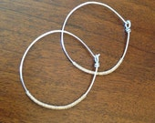 Silver with gold wrapped hoops