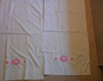 Pair of vintage white pillow cases with pink  and white crochet flowers