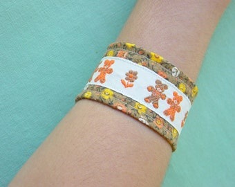 Vintage reclaimed cuff/ arm band/ brown floral with bears/ up-cycled bracelet with vintage button