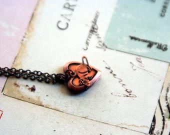 mouse.heart  necklace. copper ox color