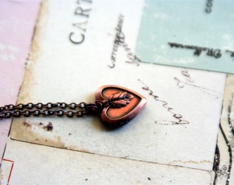 leaf locket necklace. copper ox