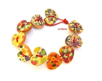 Button bracelet jewelry made of wood heart shape buttons on red leather cord