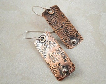 Rectangular copper earrings with texture and sterling silver accent.