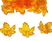 Plastic maple leaf charm beads Amber color 25pcs
