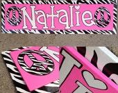 Hot pink zebra print hand lettered girls name sign