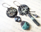 The Hidden Meaning. Vintage antique oxidized metal charms with rustic ceramic art dangles. dark asymmetrical earrings.