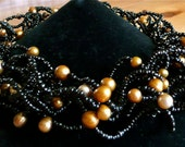 Golddigger's Daughter - Black and gold wavy choker with freshwater pearls and seedbeads