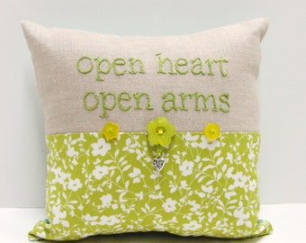 "Hand embroidered pillow- ""open heart open arms"" in leaf green on linen, flower print, buttons, heart charm"