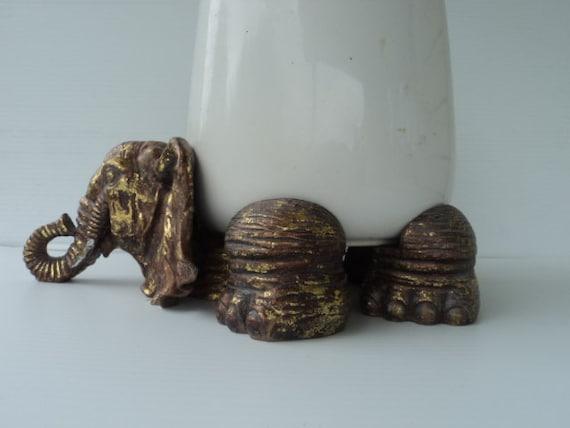 A vintage elephant bowl holder