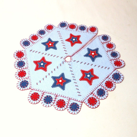 Patriotic penny rug style tree skirt with matching topper