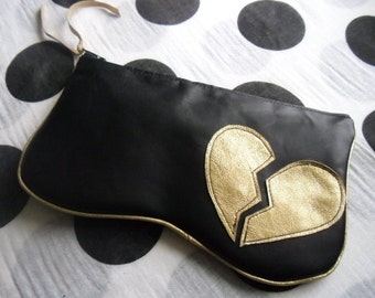Broken Heart Clutch made from new and recycled leather