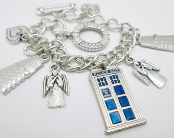 The Companion Bracelet (E001). Doctor's Police Box, Robot Villain, and Weeping Angels Charm Bracelet.