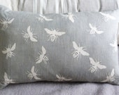 hand printed muted grey linen bee cushion cover