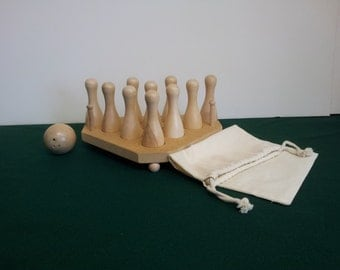 Cue Bowling Pin Set For Pool Tables with Pinsetter and Ball.