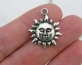 8 Sun charms antique silver tone S62