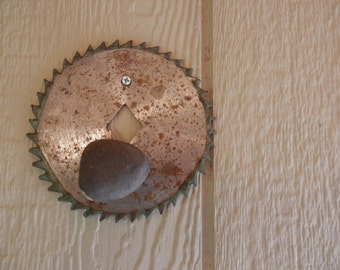 Rock wall hanger on circular saw blade