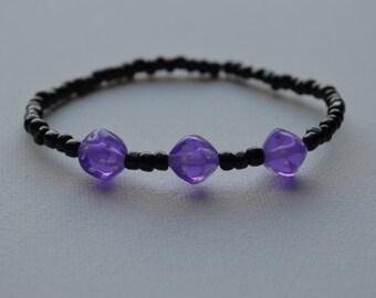 Bunco bracelet, black glass seed beads with 3 purple dice, stretch bracelet