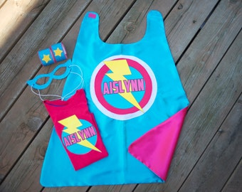 Girls - SUPERHERO CAPE SET - With personalized cape and iron-on t shirt decal, mask, & arm bands - Customized Girls Costume