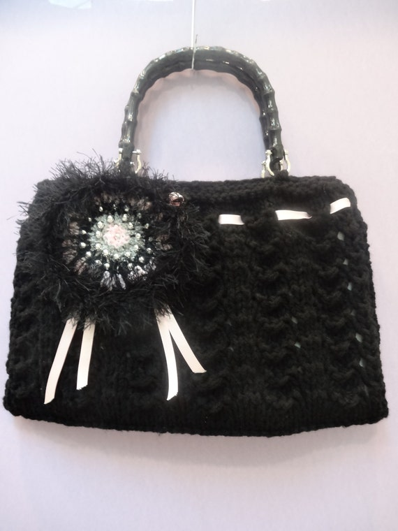 KNITTED HANDBAG/PURSE, Oversized, Black, hand knitted, in a designer style,fully lined with a removable velvet rose and satin ribbons