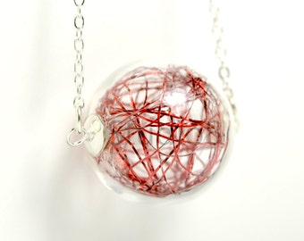 Metallic red thread in hand blown glass ball silver necklace