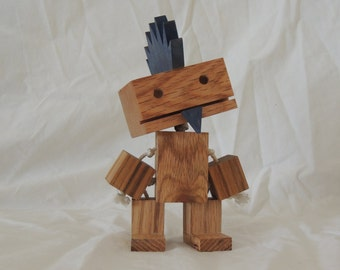 Wooden robot with a Mohawk.....and a soul patch.